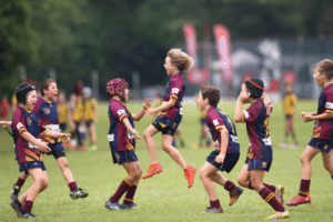 young rugby team celebrates at turf city