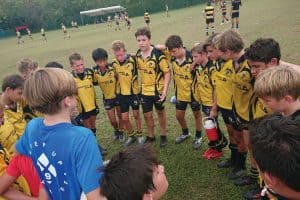 Kids rugby team huddle